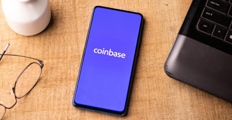 Coinbase logo on a smartphone on a desk